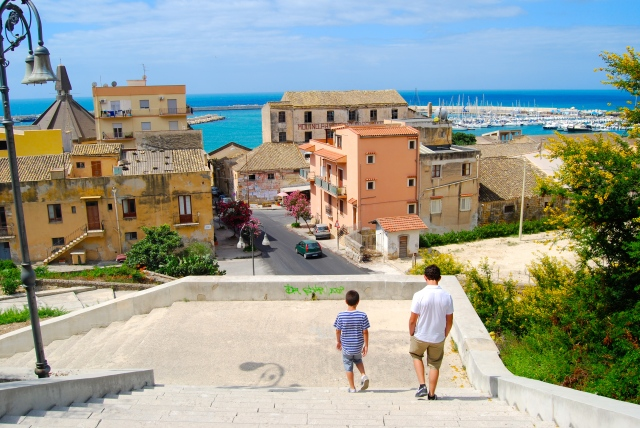 Luca and Sean descend Sciacca's city steps.